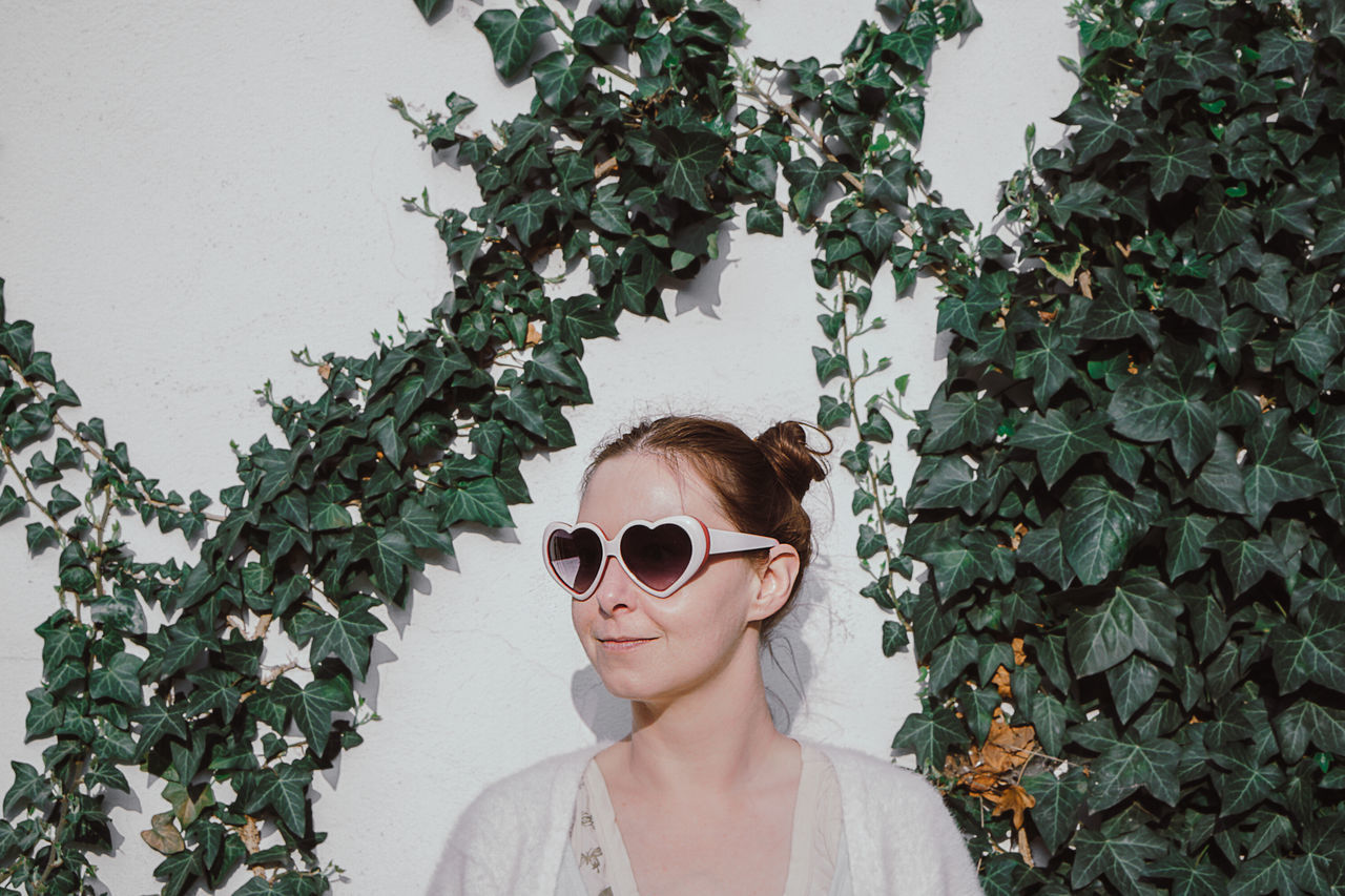 Portrait One Woman Only One Person People Beautiful Woman Beautiful People Adult Plant Sunglasses Adult Nature Headshot Heart Shape Sunny Day Nature Plant Green Color Freshness Standing Portrait Of A Woman Ivy Wall Ivy Young Adult Young Women EyeEm Gallery The Portraitist - 2017 EyeEm Awards