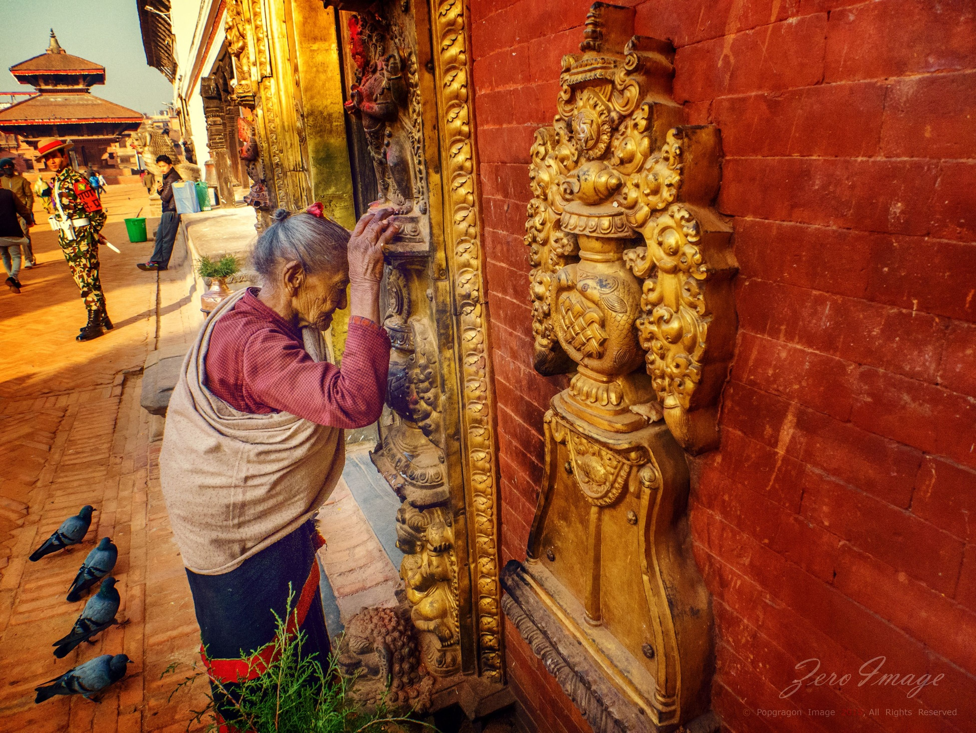 art, art and craft, creativity, religion, human representation, cultures, person, red, spirituality, men, architecture, statue, built structure, tradition, indoors, retail, lifestyles, traditional clothing