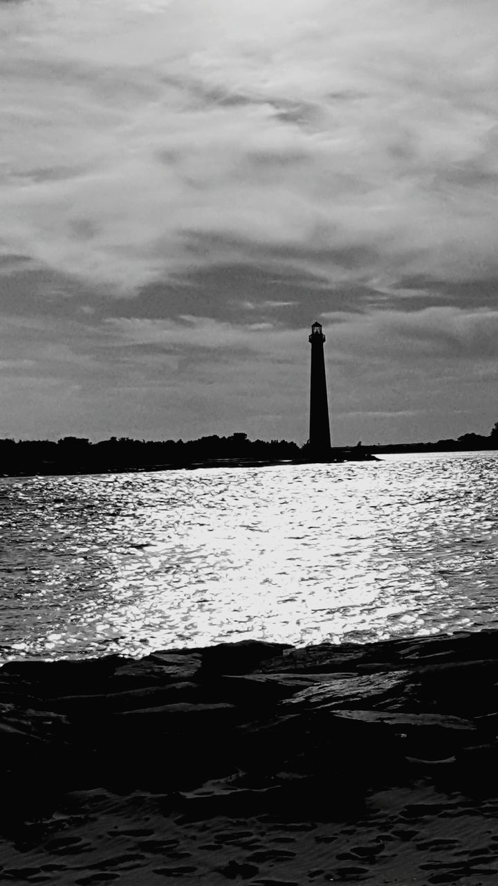 lighthouse, sky, cloud - sky, water, guidance, architecture, sea, built structure, building exterior, nature, no people, waterfront, outdoors, day, beauty in nature