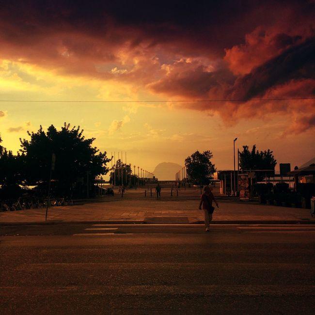 Walk unafraid Tree Sunset Walking Street Full Length Road Palm Tree Sky Cloud - Sky Outdoors Dramatic Sky Person