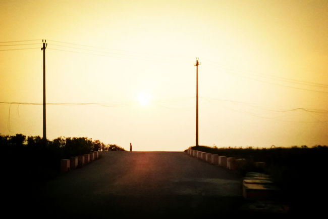 Alone Beauty In Nature Calm Country Road Countryside Empty Road Nature Nature Photography Nature_collection On The Road On The Way On The Way Home Orange Color Outdoors Road Scenery Sunset Waiting Walking Around