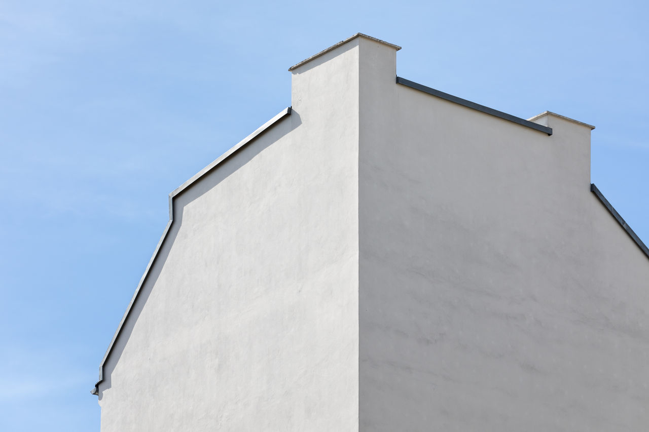 White house walls without windows against blue sky Abstract Architectural Feature Architecture Architecture Blue Building Exterior Built Structure City Clear Sky Close-up Concrete Copy Space Corner Façade High Section Low Angle View No People Outdoors Roof Shape Simplicity Sky Sunny Wall - Building Feature White Color