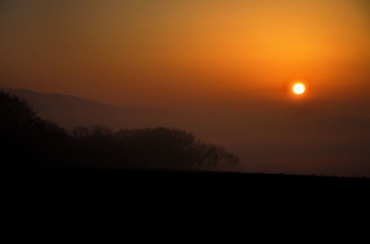 Astronomy Beauty In Nature Fog Landscape Mountain Nature No People Orange Color Outdoors Scenics Silhouette Sky Sun Sunset Tranquil Scene Tranquility Tree