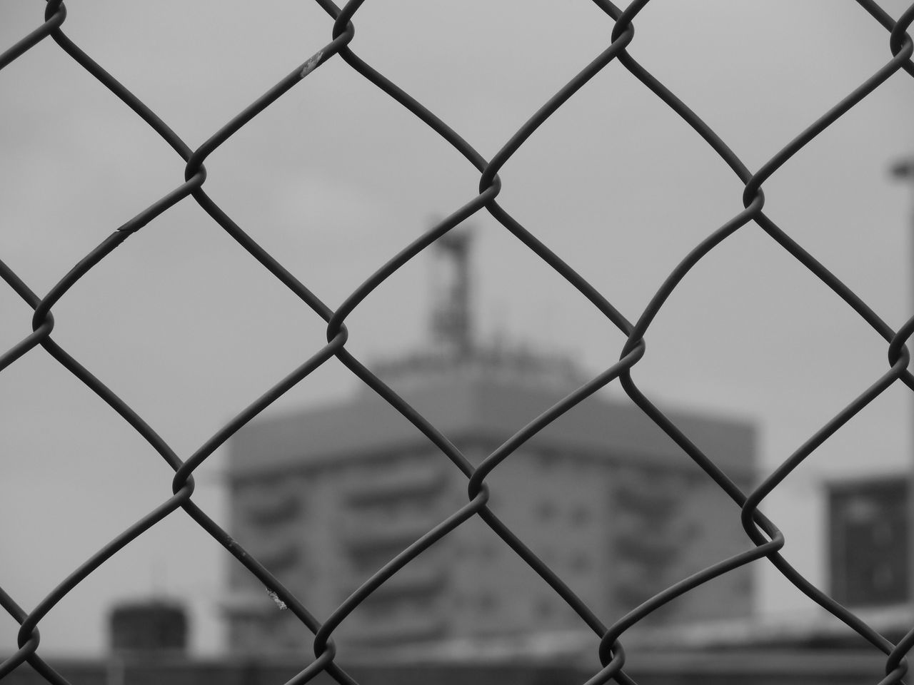 chainlink fence, protection, safety, metal, security, full frame, focus on foreground, close-up, pattern, day, sky, outdoors, no people, backgrounds, crisscross, city, nature