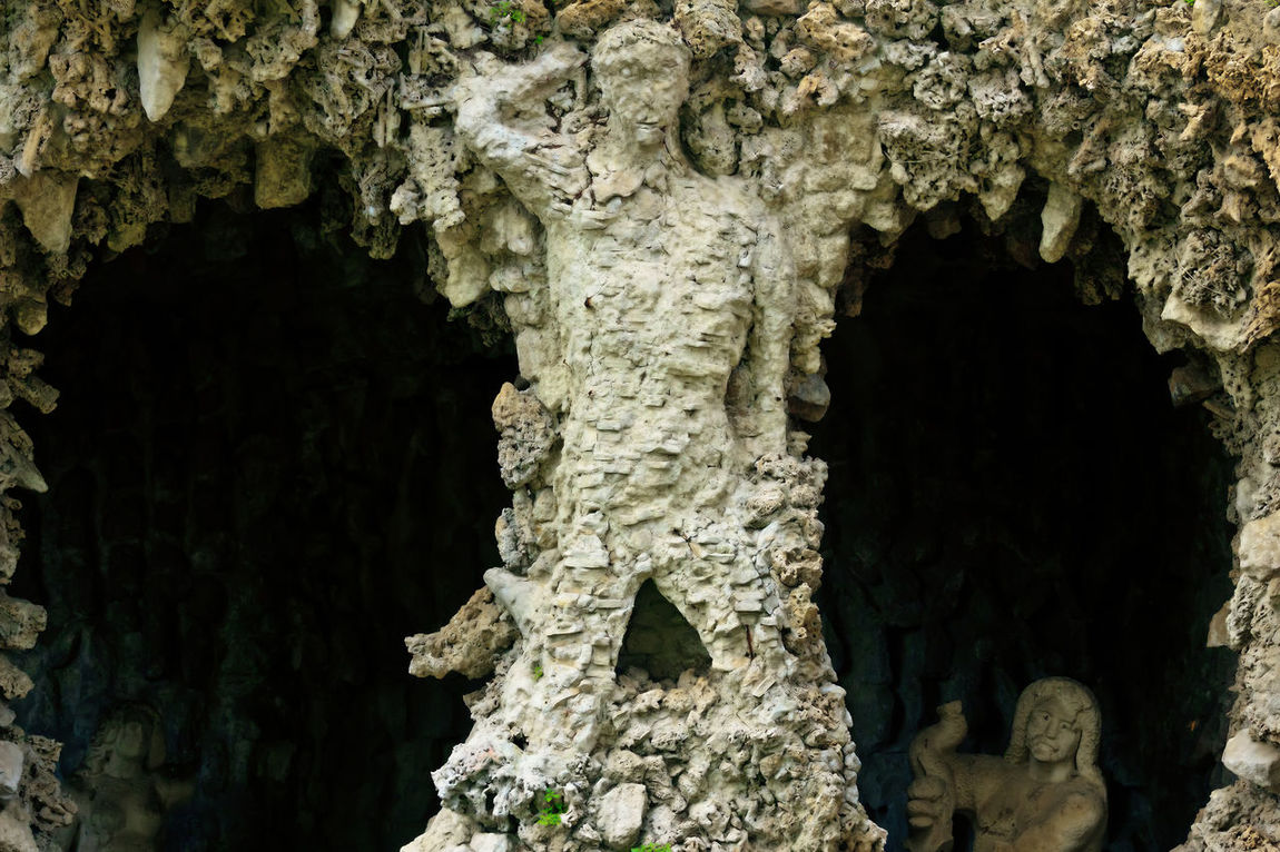 Stone sculpture of man and woman with caves Architecture Built Structure Cave Close-up Day Human Representation Indoors  Nature No People Rock - Object Rome Italy Rough Sculpture Stalactite  Textured  Tree Trunk Villa Pamphili