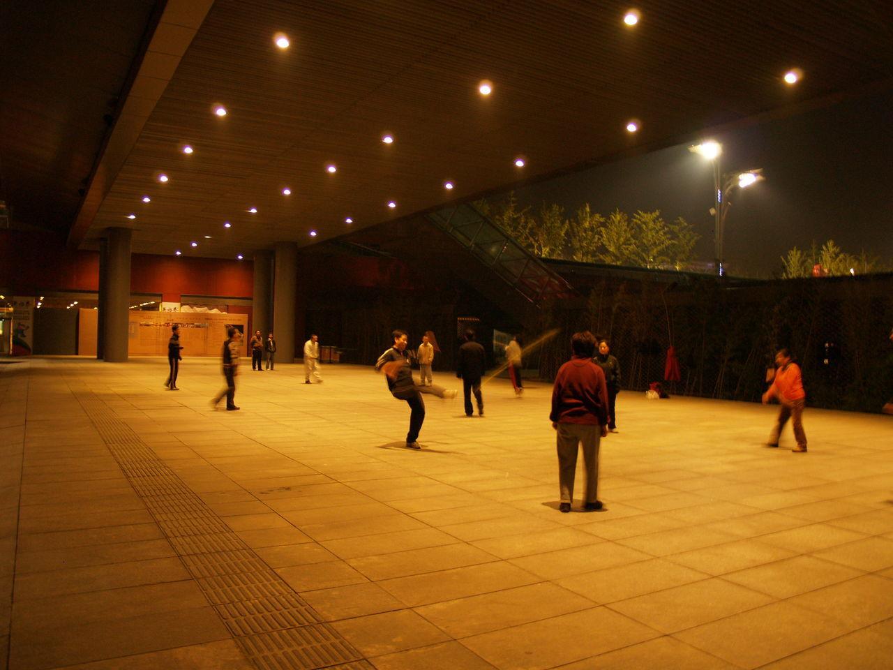 illuminated, men, indoors, leisure activity, large group of people, women, lifestyles, night, people