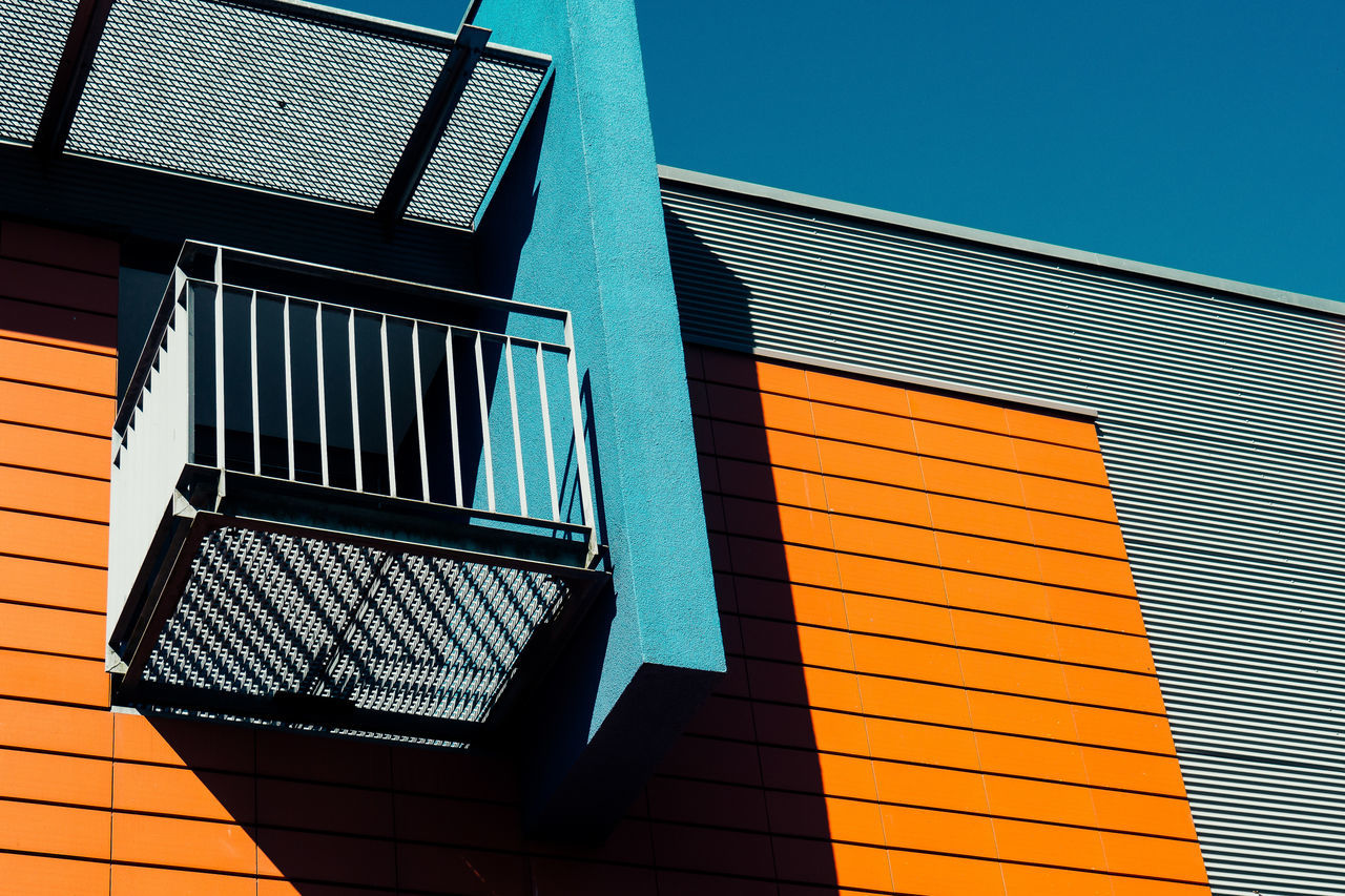 blue / orange Architecture Balcony Blue Building Exterior Built Structure Clear Sky Day Low Angle View Modern No People Orange Outdoors Sky Window