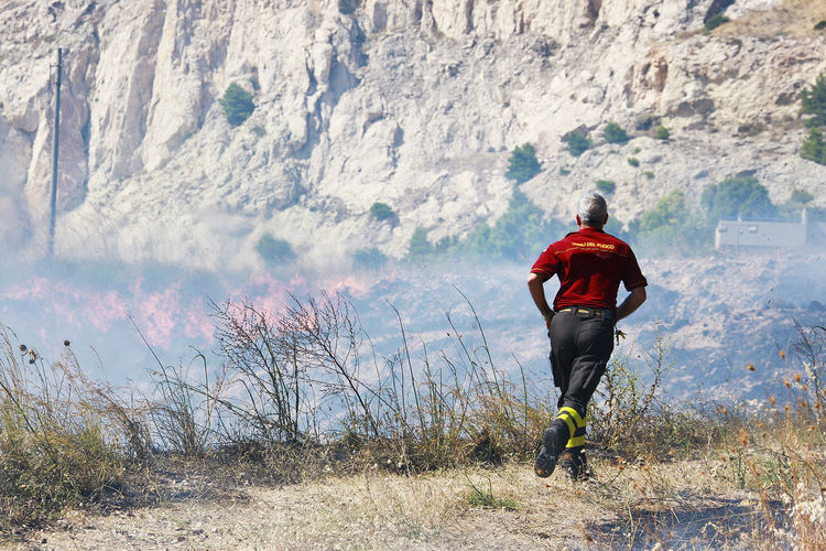 fireman in action Blaze Nature Protezione Civile Sicily Smoke Adventure Arson  Day Fire Fireman Important Important Work Men Mountain Nature One Person Outdoors Police Rear View