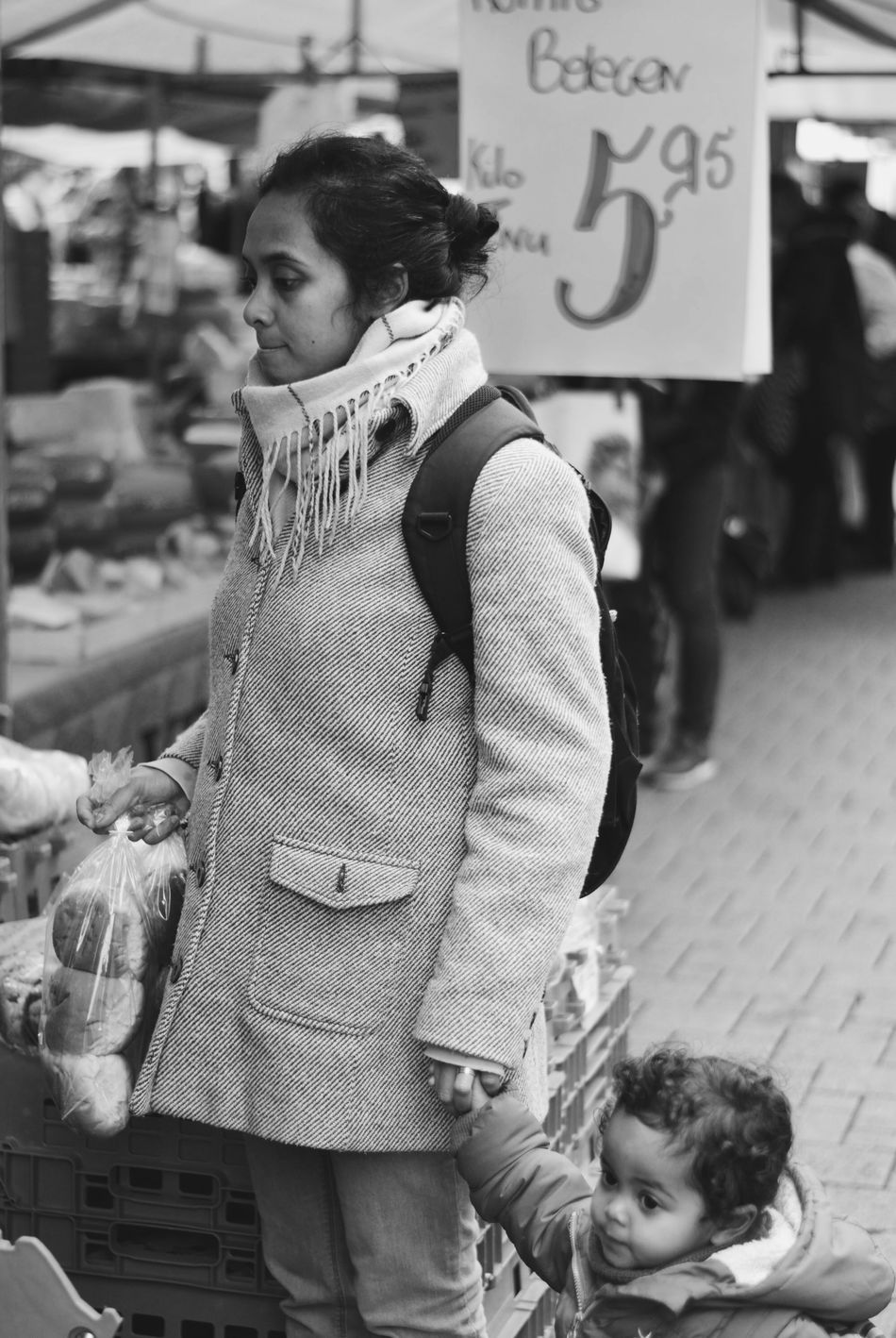 A woman in Amersfoort Casual Clothing Market Mom With Child Mom With Daughter Portrait Side View Street Street Photography Street Portrait Streetphoto_bw Streetphotography Woman Staring Young Adult