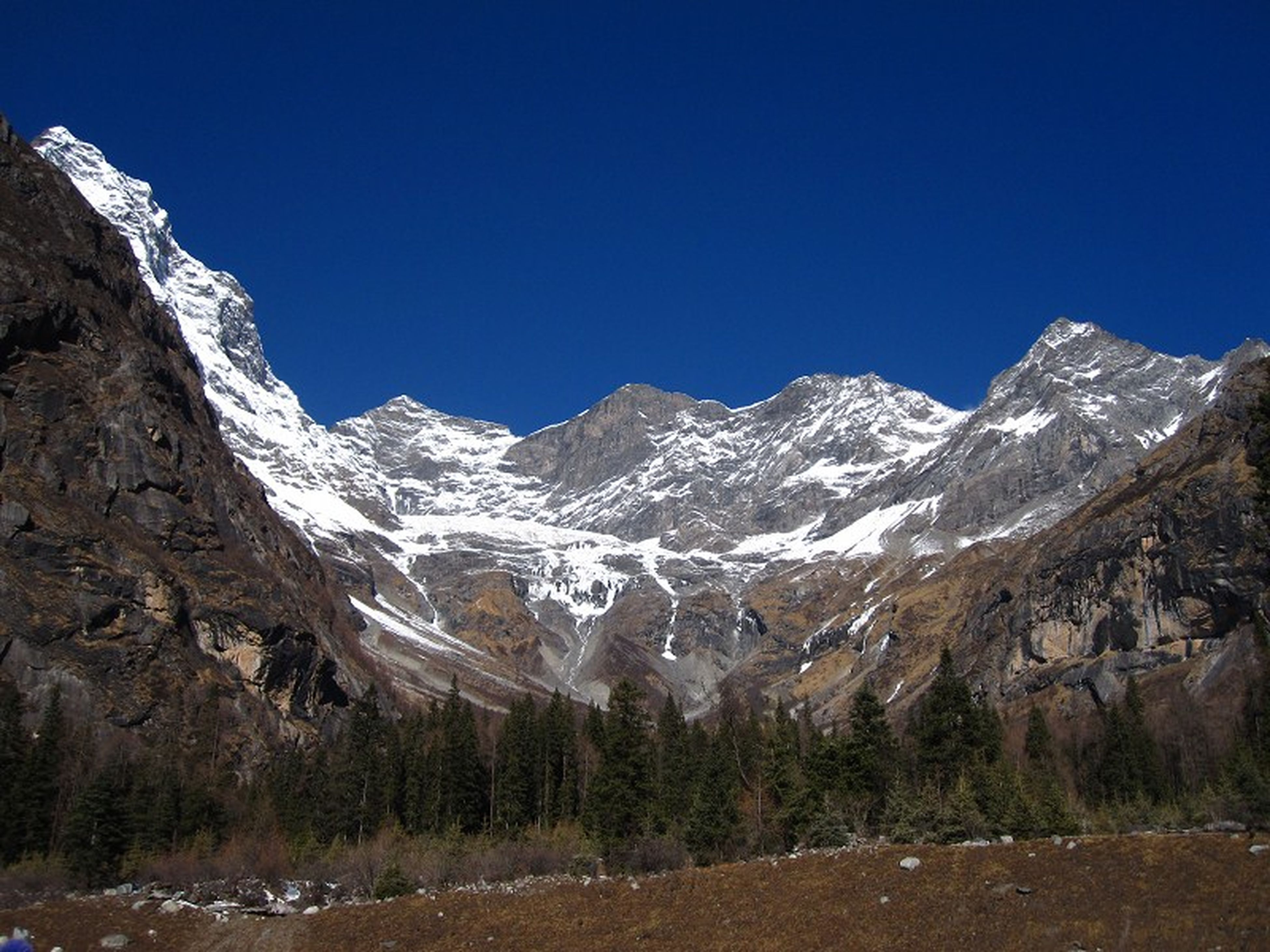 mountain, snow, winter, cold temperature, clear sky, mountain range, blue, season, snowcapped mountain, tranquil scene, scenics, tranquility, beauty in nature, copy space, landscape, nature, non-urban scene, rocky mountains, weather, rock - object