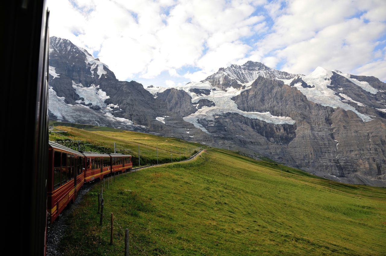 Train Towards Snowcapped Mountain