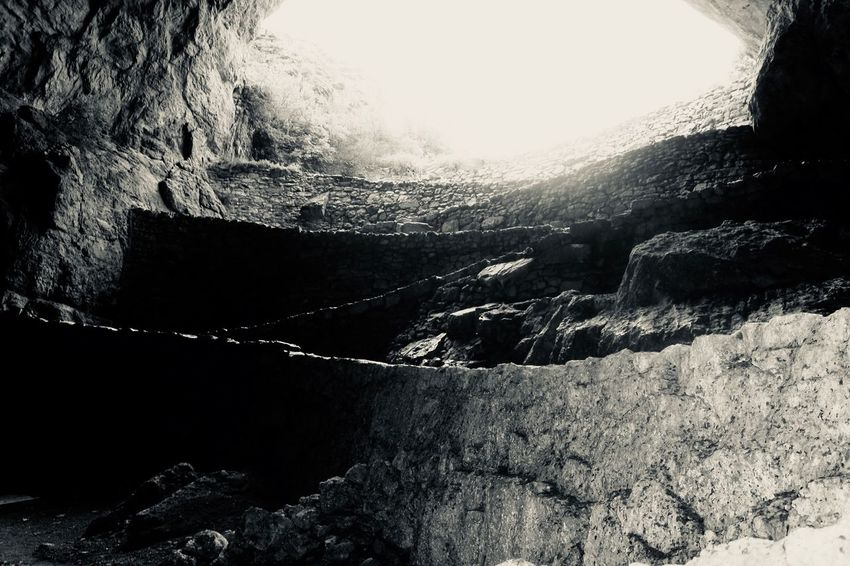 The entrance to Carlsbad Caverns Bnw Black And White Blackandwhite Rock - Object Rock Formation Geology Nature Beauty In Nature No People Tranquility Tranquil Scene Physical Geography Mountain Scenics Cliff Cave Day Outdoors Water Power In Nature Rock Face