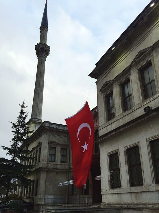 Red turkish flag is hanging on the historical building in Istanbul as a sign of patriotism Architecture Beautiful Building EyeEm EyeEm Best Shots EyeEm Gallery Flag Hanging Islam Istanbul Minaret Moon And Star Mosque National Patriot Patriotism Pride Red Religion Spirit Turkey Turkish Flag