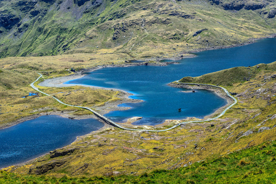 View from the Pyg trail on the way to the summit of Mount Snowdon. Beauty In Nature Blue Elevated View Grass Hiking Hiking Trail Lake Lake View Landscape Llyn Llydaw Mountain Mountains Nature Outdoors Pyg Trail Remote Rugged Beauty Scenics Snowdon Snowdonia The Great Outdoors - 2016 EyeEm Awards Tranquil Scene United Kingdom Wales Water