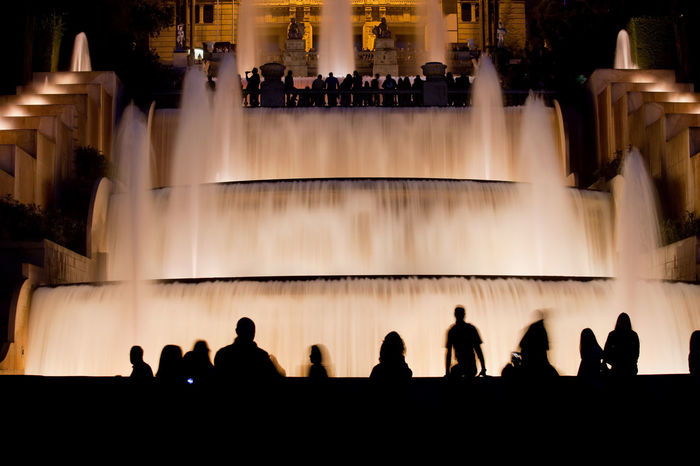 Stepped fountain and water cascades illuminated at night in Barcelona, Catalonia, Spain Barcelona Catalonia Catalunya City Break Fountain Light Montjuic SPAIN Europe Illmination Illuminated Large Group Of People Men Montjuic Hill Night Real People Shadow Silhouette Spectator Stepped Terraced Watching Water Water Cascade Women