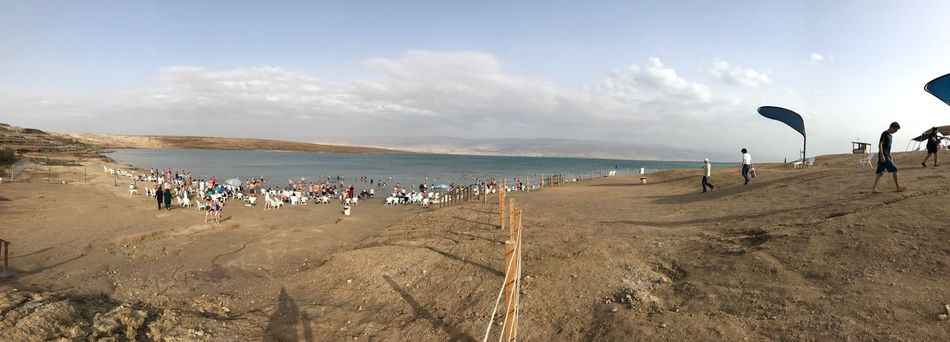 Israel Telaviv Beach Sea Large Group Of People Sky Sand Outdoors Shore Nature Beauty In Nature Scenics Water Day Mountain Real People Standing Cloud - Sky Vacations Men Horizon Over Water People Deadsea