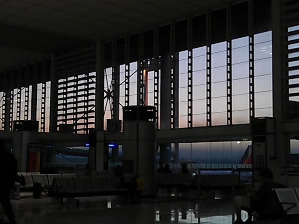 Sunrise and Silhouette while waiting for a flight in Manila Airport Eyeem Philippines Light And Shadow Taking Photos Traveling Darkness And Light