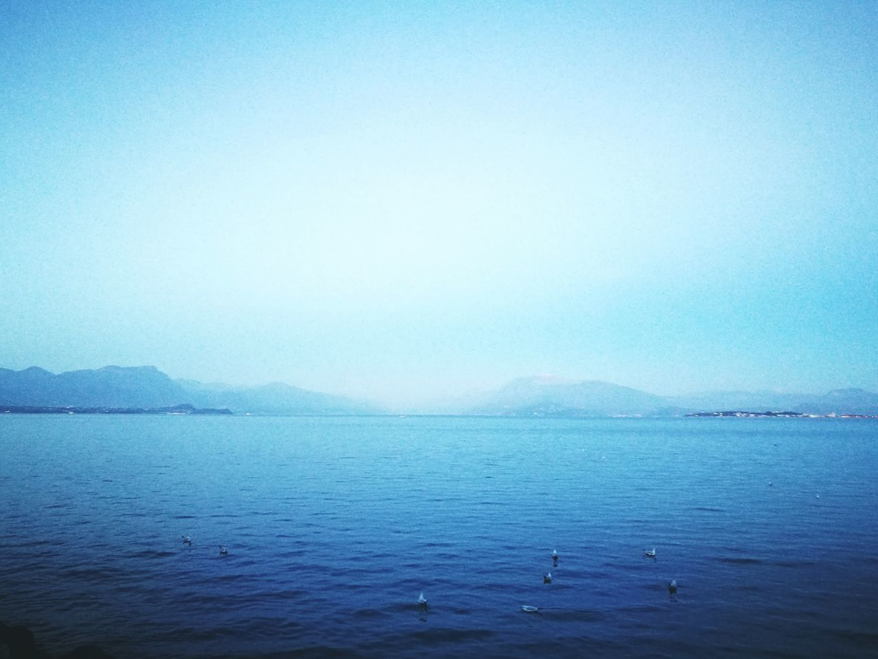tranquility, copy space, water, scenics, tranquil scene, beauty in nature, blue, clear sky, nature, no people, sea, outdoors, mountain, day, sky