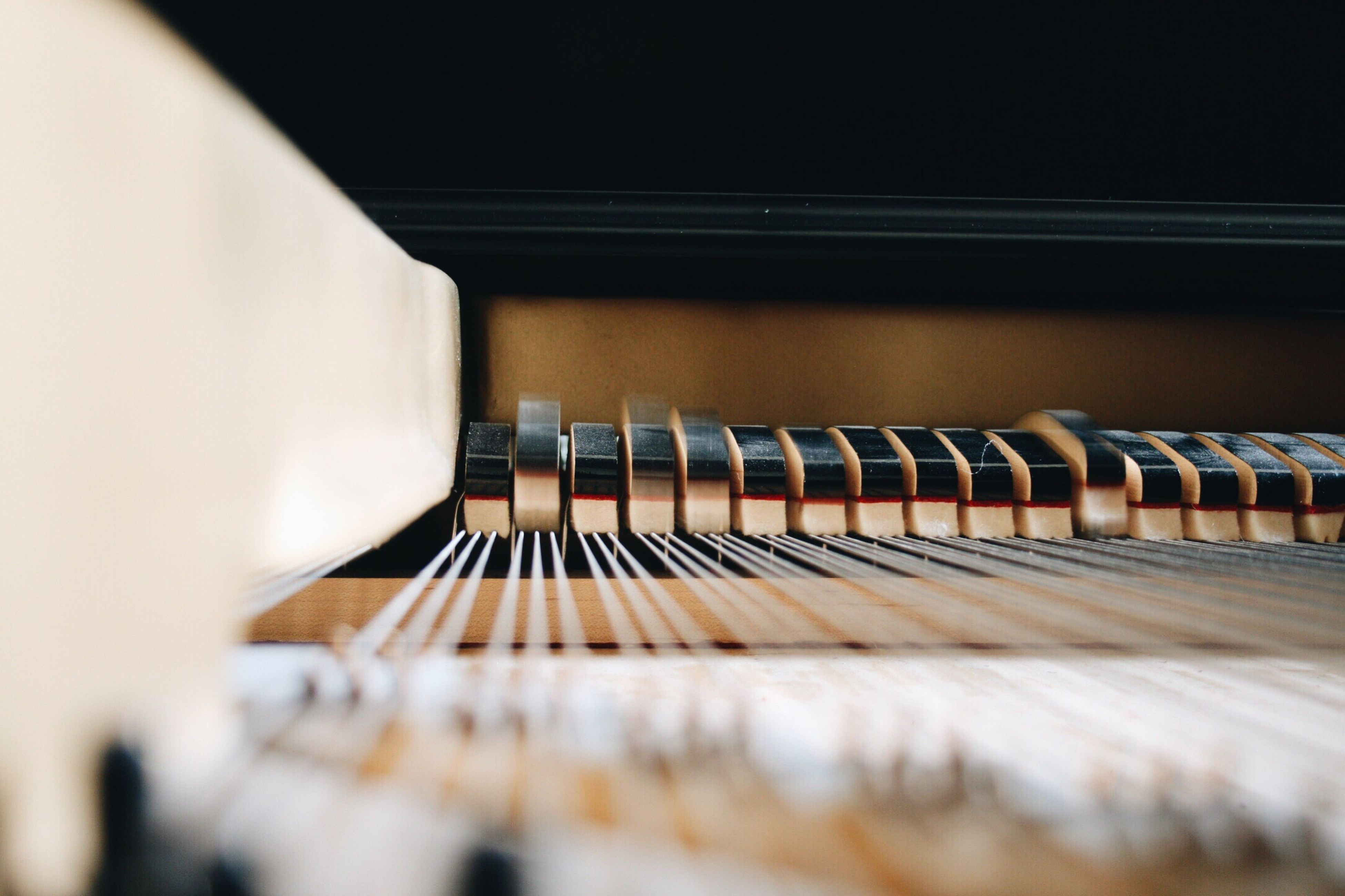musical instrument, music, indoors, selective focus, piano, arts culture and entertainment, close-up, piano key, in a row, hobbies, surface level, musical equipment, string instrument, repetition, order, differential focus, diminishing perspective