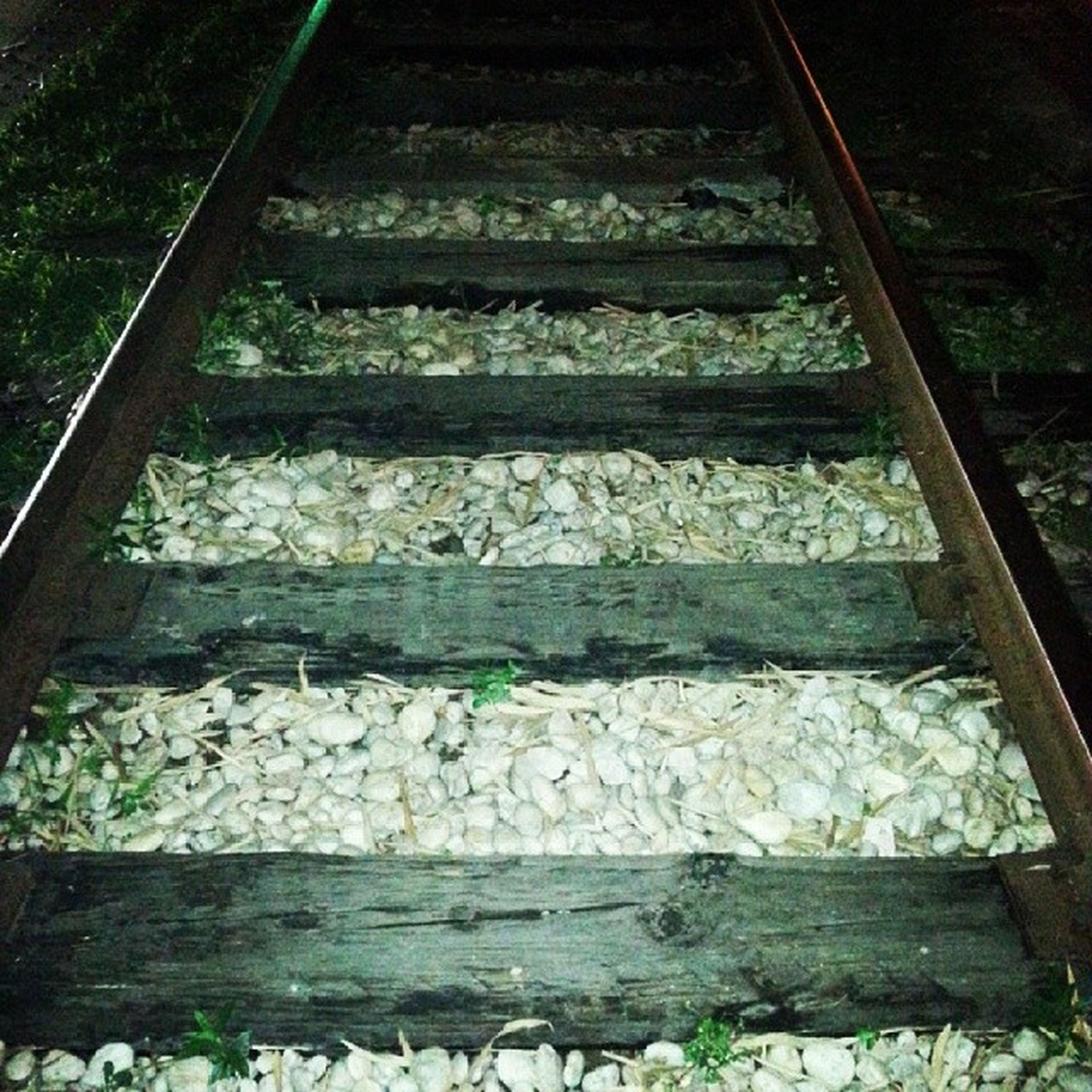 steps, steps and staircases, railing, staircase, high angle view, metal, wood - material, the way forward, pattern, outdoors, low angle view, sunlight, stairs, no people, day, railroad track, close-up, textured, nature, diminishing perspective
