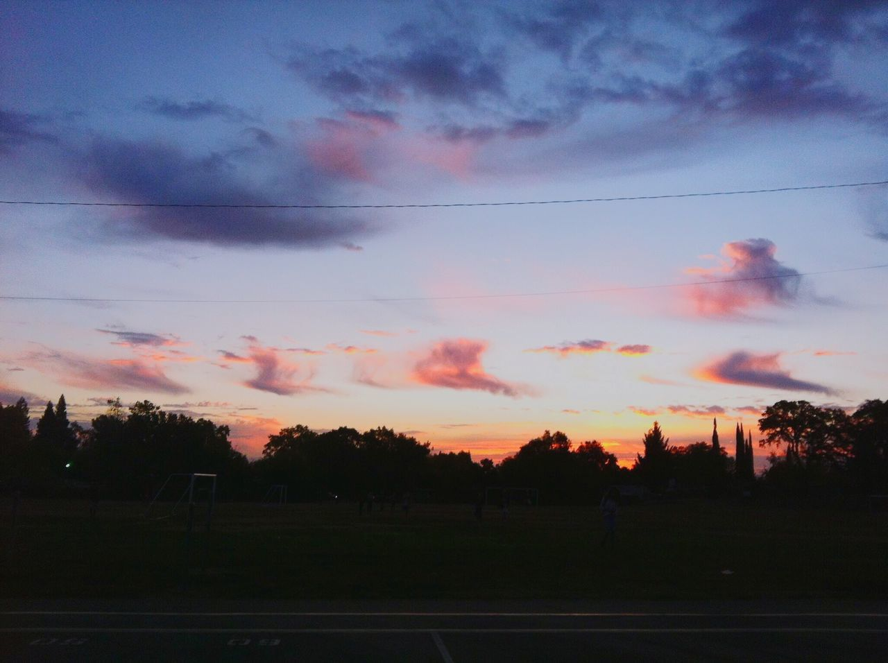 sunset, sky, cloud - sky, silhouette, no people, tree, nature, beauty in nature, tranquility, outdoors, scenics, landscape, soccer field, day