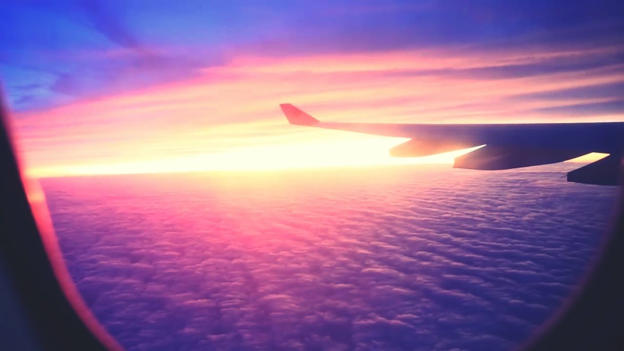 airplane, transportation, sunset, journey, air vehicle, sky, aircraft wing, mode of transport, airplane wing, flying, travel, beauty in nature, cloud - sky, nature, aerial view, scenics, sun, no people, mid-air, tranquility, outdoors, water, day, close-up