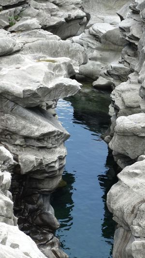 Beauty In Nature Close-up Day Idyllic Natural Pattern Nature No People Non-urban Scene Outdoors Physical Geography Reflection Remote Rippled River Rock Rock - Object Rock Formation Scenics Standing Water Stone Tranquil Scene Tranquility Travel Destinations Valle Maggia, Switzerland Water