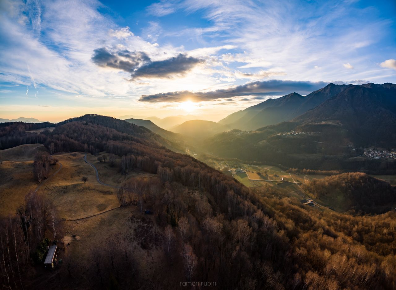 EyeEmNewHere Landscape Travel Mountain Nature Beauty In Nature Sunlight Outdoors Cloud - Sky Sunset Growth Social Issues No People Scenics Tree Sky Backgrounds Tranquility Multi Colored Aerial Shot Village Aerial Photo Nature light and reflection Tree