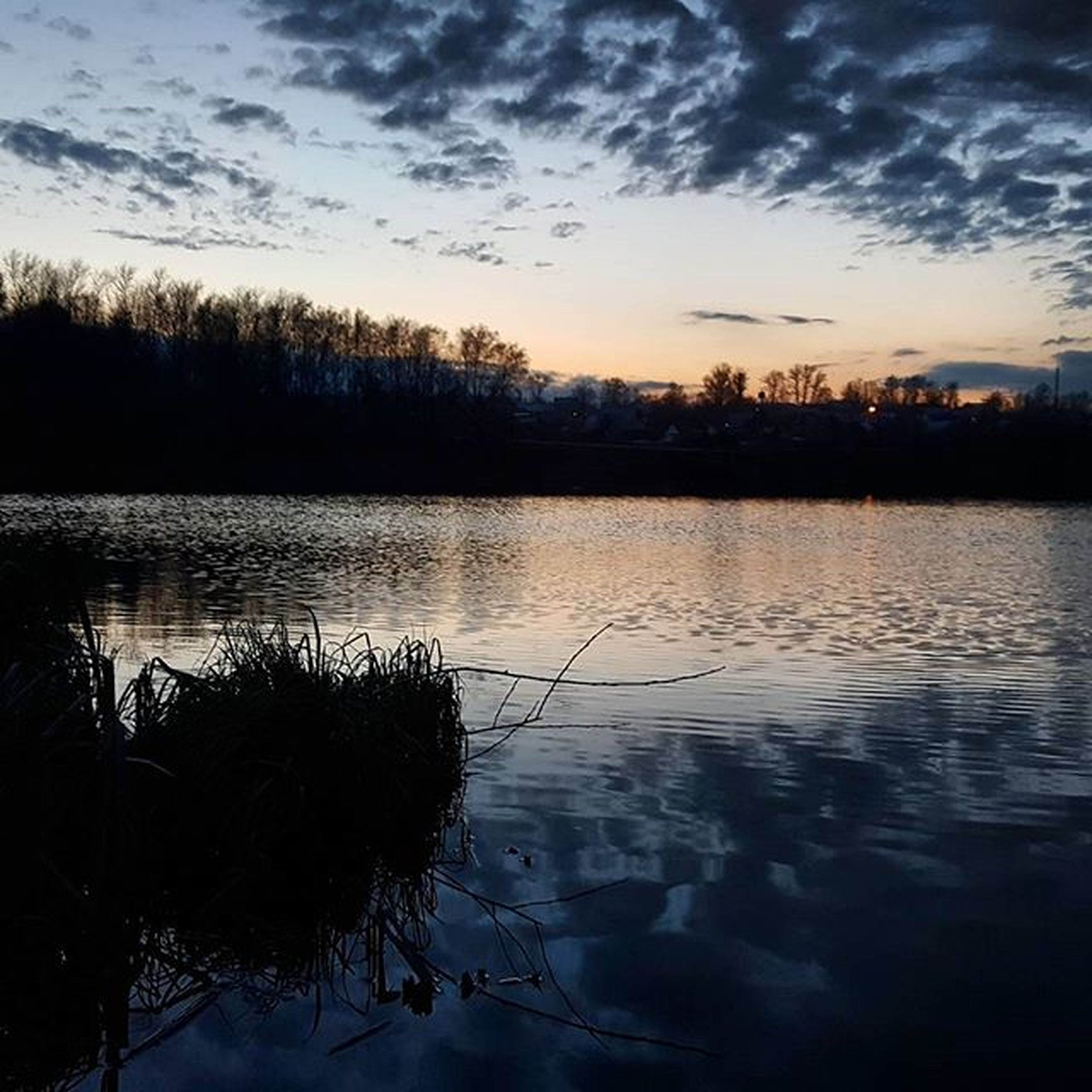 water, sunset, reflection, silhouette, lake, sky, tranquility, tranquil scene, scenics, beauty in nature, cloud - sky, waterfront, nature, tree, cloud, river, idyllic, dusk, outdoors, no people