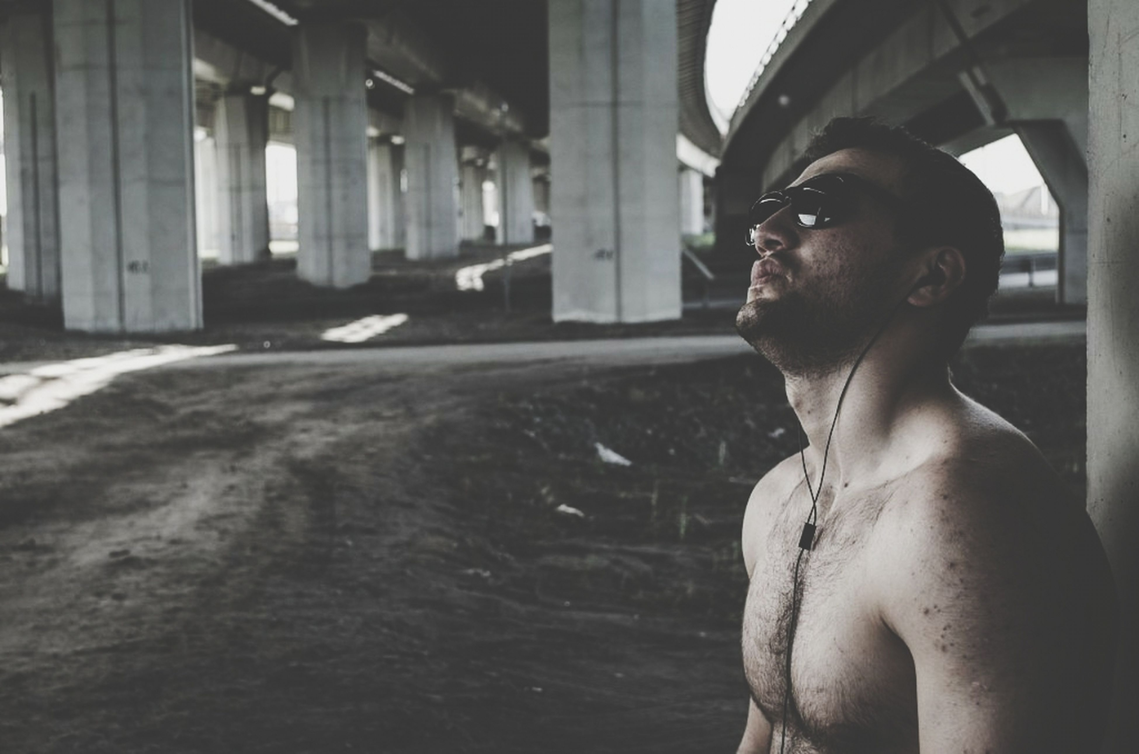 architecture, young adult, built structure, person, indoors, portrait, looking at camera, young men, headshot, lifestyles, building exterior, water, contemplation, front view, leisure activity, day, mid adult