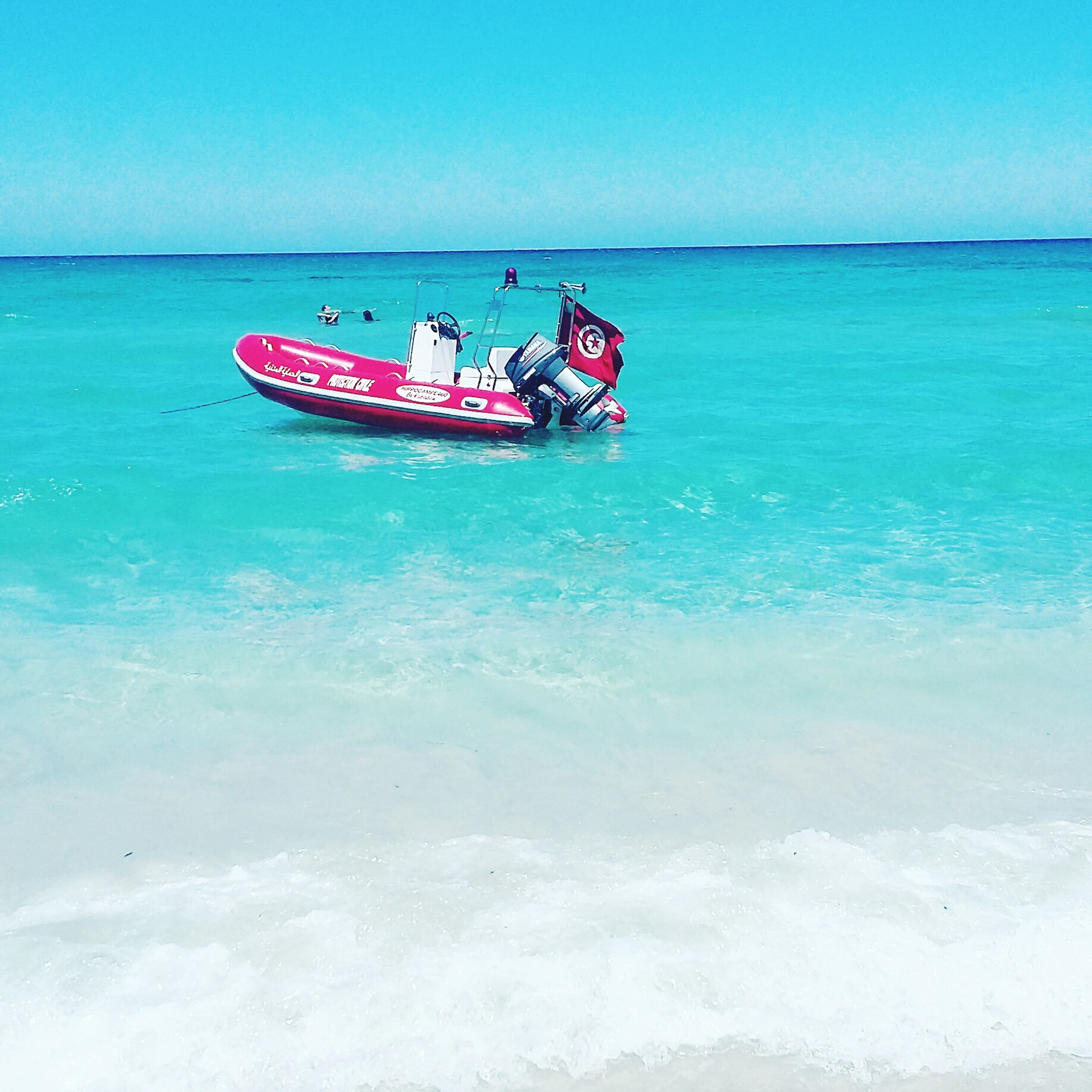 sea, water, nautical vessel, mode of transport, blue, horizon over water, boat, tranquility, nature, scenics, beauty in nature, vacations, tranquil scene, day, leisure activity, sky, outdoors, rippled, idyllic, enjoyment, fun, tourism, lifestyles, non-urban scene, ocean, travel destinations, remote