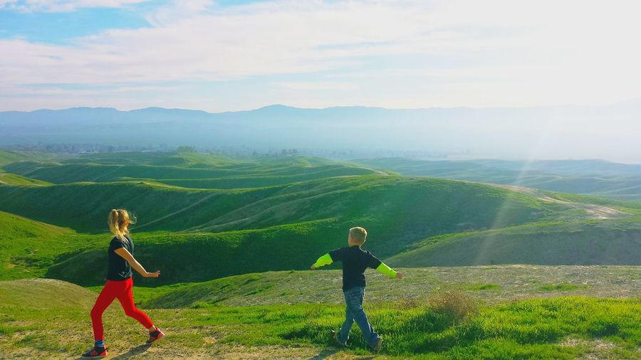 The Great Outdoors - 2016 EyeEm AwardsSunny Days Walking On Sunshine Little Boy Little Girl Hiking Adventures Kids Having Fun Siblings Walking Hills And Valleys Greenery Beautiful Nature Sunshine Spring 2016 Summer Time  New Journey Begins