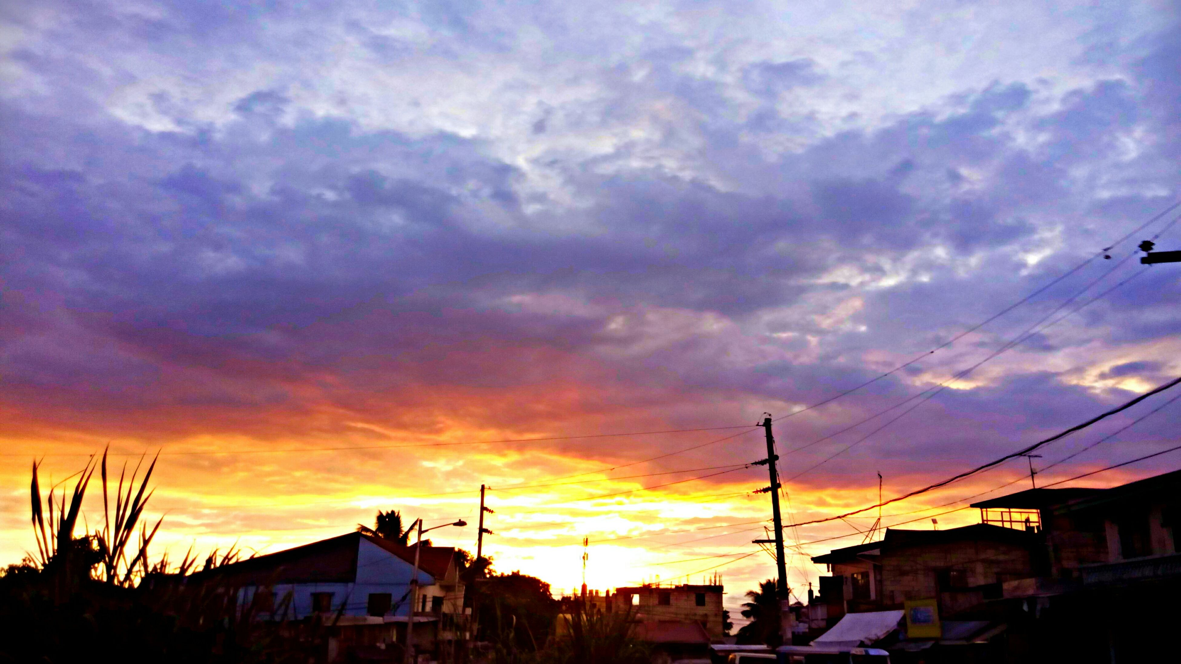 building exterior, architecture, sunset, built structure, sky, cloud - sky, house, residential structure, cloudy, residential building, cloud, orange color, low angle view, silhouette, city, building, dramatic sky, town, outdoors, residential district