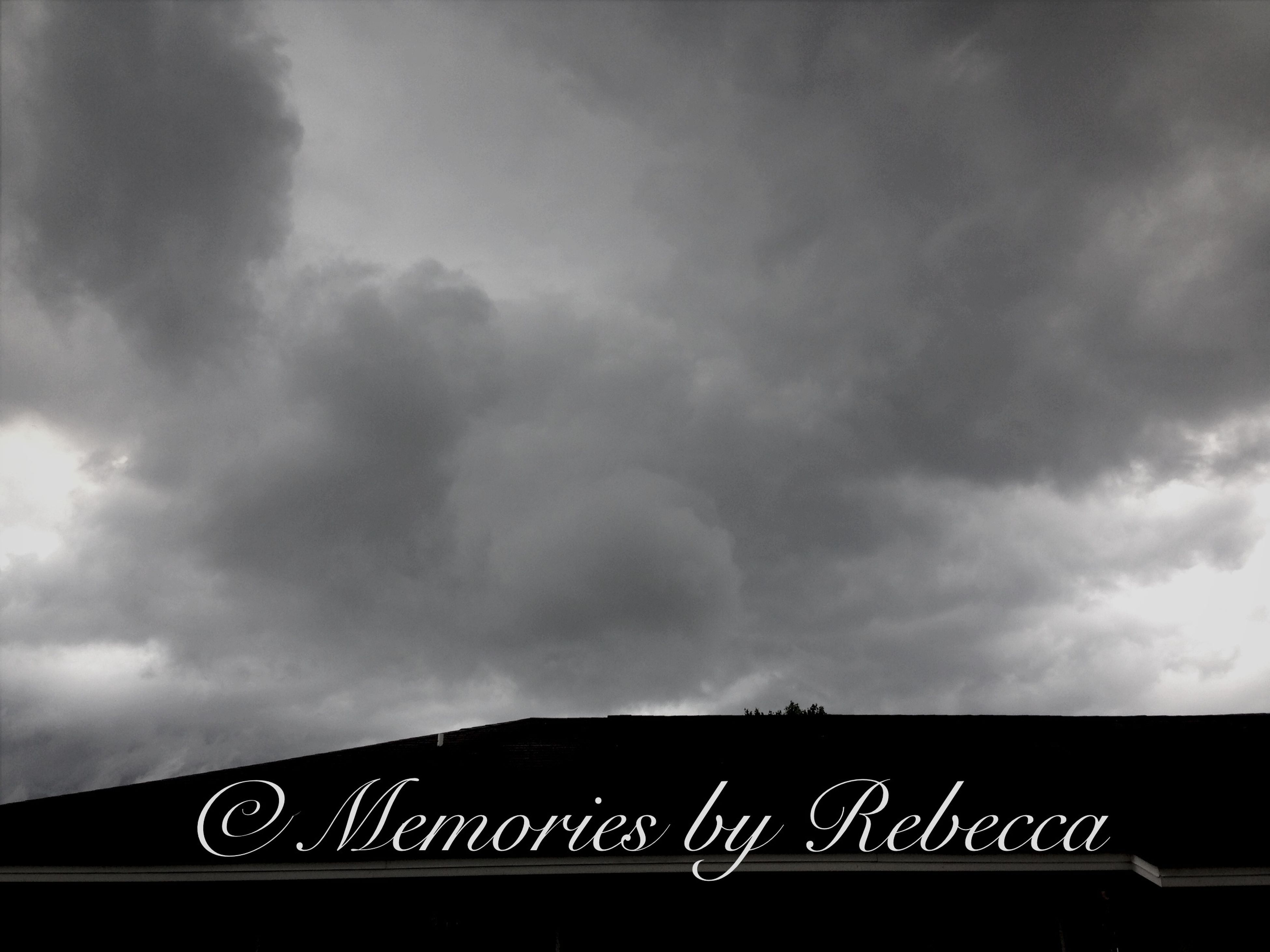 sky, cloud - sky, cloudy, low angle view, railing, transportation, cloud, text, overcast, weather, western script, silhouette, dusk, communication, outdoors, storm cloud, sign, day, built structure, no people