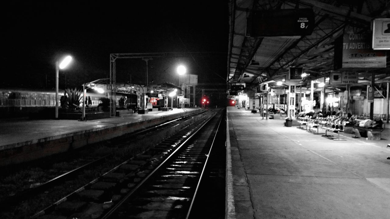 Late night wait at the Kottayam Railway station. Illuminated India Kerala Kottayam Night Night Photography Public Transportation Railroad Station Railroad Station Platform Railroad Track Railway Railwaystation Selective Color Transportation