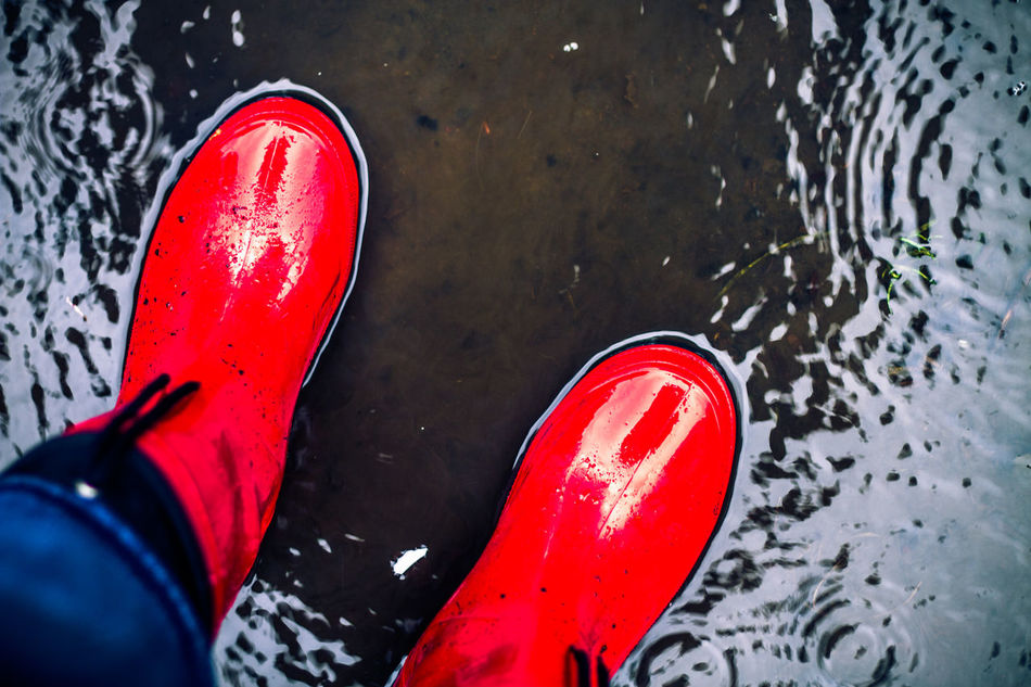 Adult Adults Only Berlin Canvas Shoe Close-up Day High Angle View Human Body Part Human Leg Lifestyles Low Section One Person Outdoors Pair People Personal Perspective Real People Red Rubber Boots Shoe Standing Water Wet