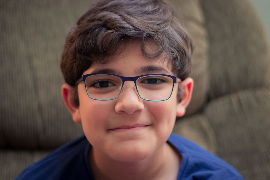 Childhood Portrait Eyeglasses  Looking At Camera Headshot Real People One Person Focus On Foreground Close-up Elementary Age Boys Smiling Day Indoors  People