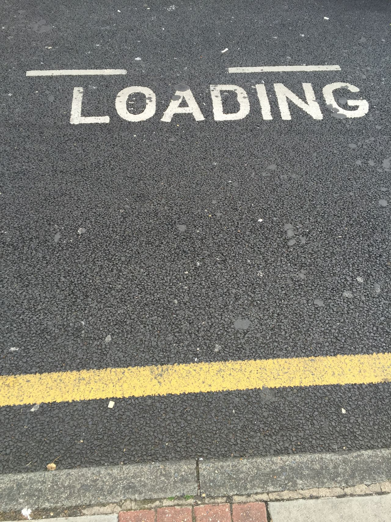 Loading bay road markings sign on tarmac Roadside Road Roadsign Loading Loading Bay Loadingbay