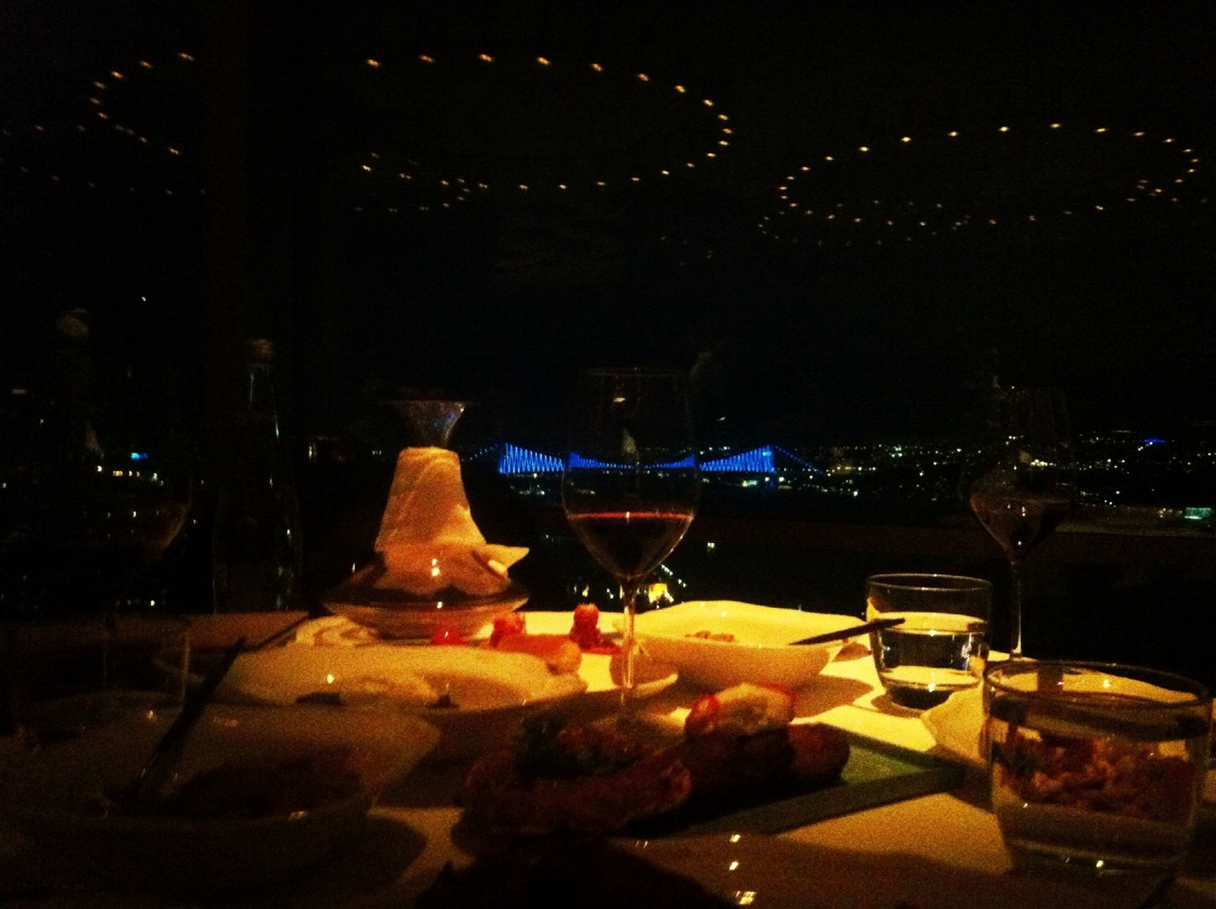 night, food and drink, illuminated, food, table, freshness, indoors, ready-to-eat, restaurant, unhealthy eating, still life, glowing, indulgence, dark, fire - natural phenomenon, burning, plate, close-up, no people, sweet food
