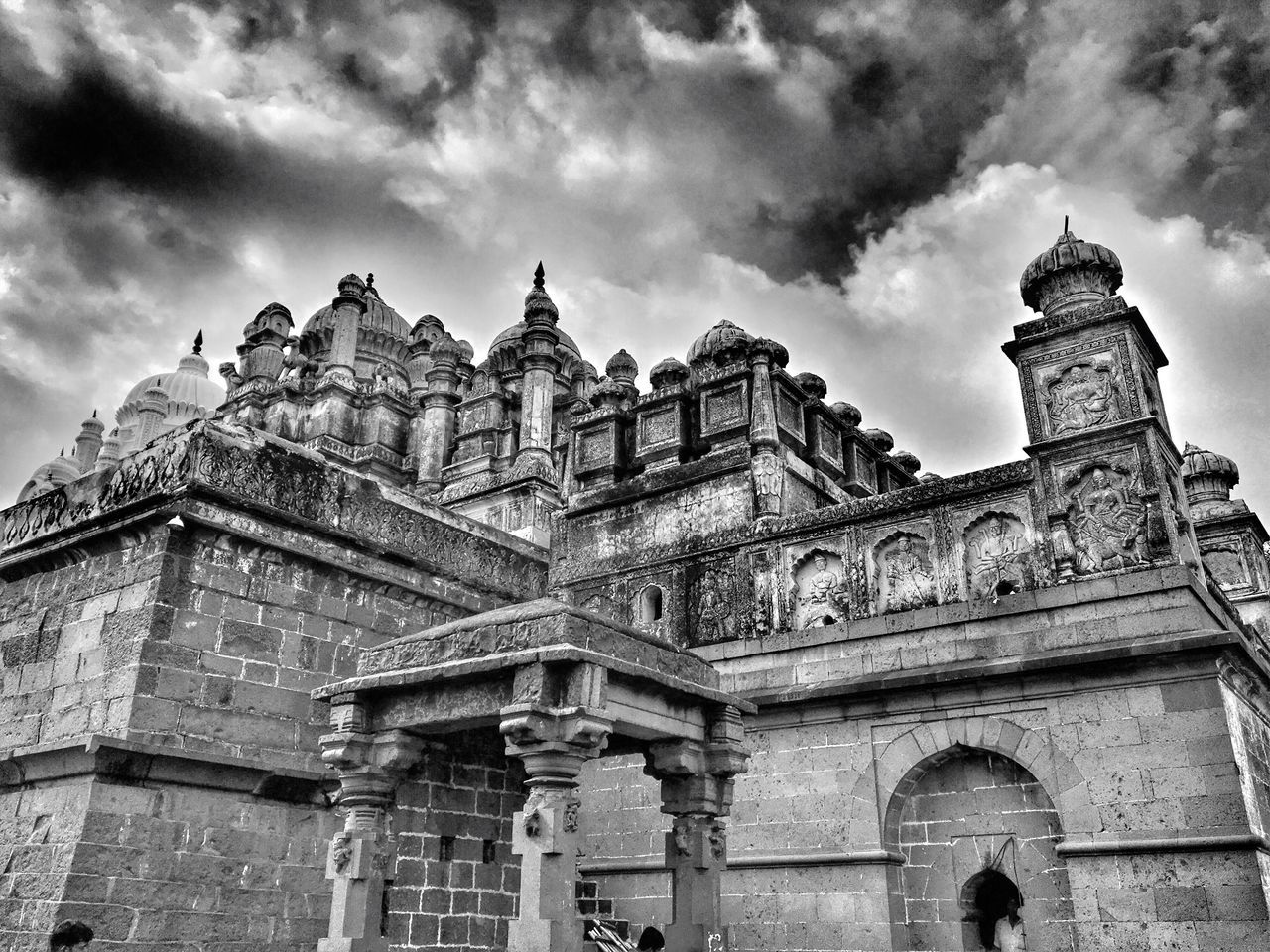 architecture, built structure, building exterior, sky, cloud - sky, low angle view, religion, history, spirituality, place of worship, outdoors, day, no people, statue, travel destinations, sculpture, city, ancient civilization