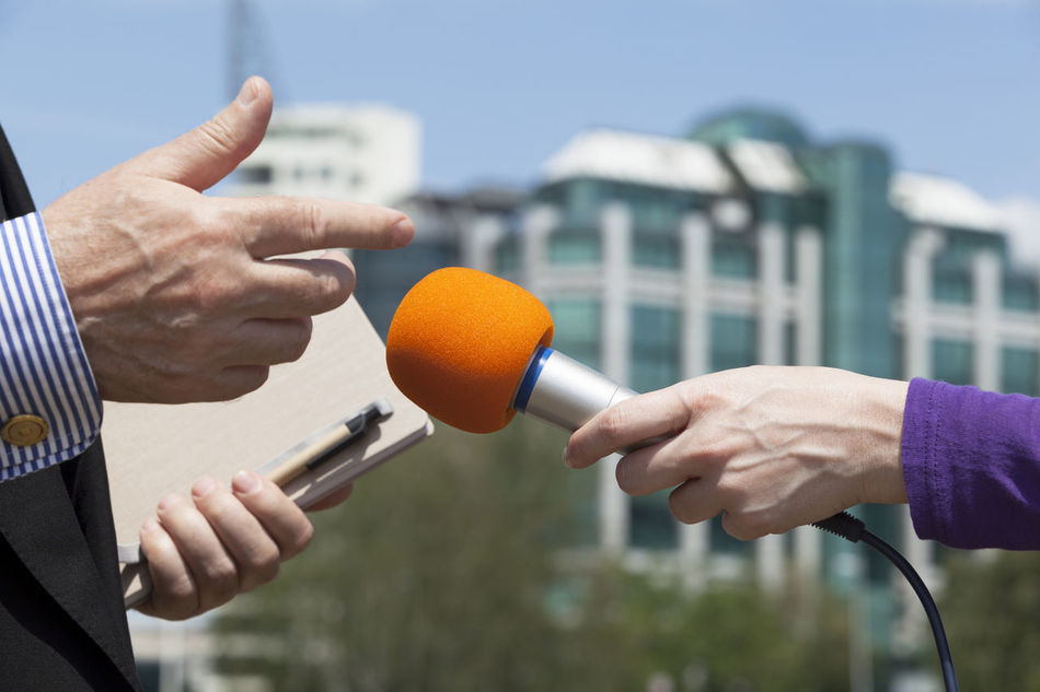 Journalist making press interview with microphone Adult Broadcasting Businessman City Human Body Part Human Hand Information Interview Day  Journalist Media Men Microphone No People Only Men Outdoors People Person Politician Spokesman