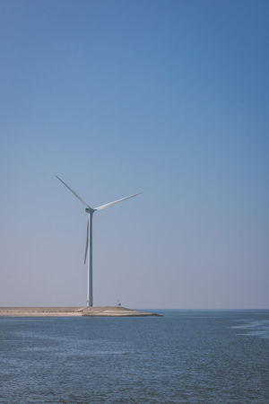 Windmill near sea Alternative Energy Clear Sky Day Environmental Conservation Fuel And Power Generation Horizon Over Water Nature No People Outdoors Renewable Energy Sailing Sea Sky Water Wind Power Wind Turbine Windmill
