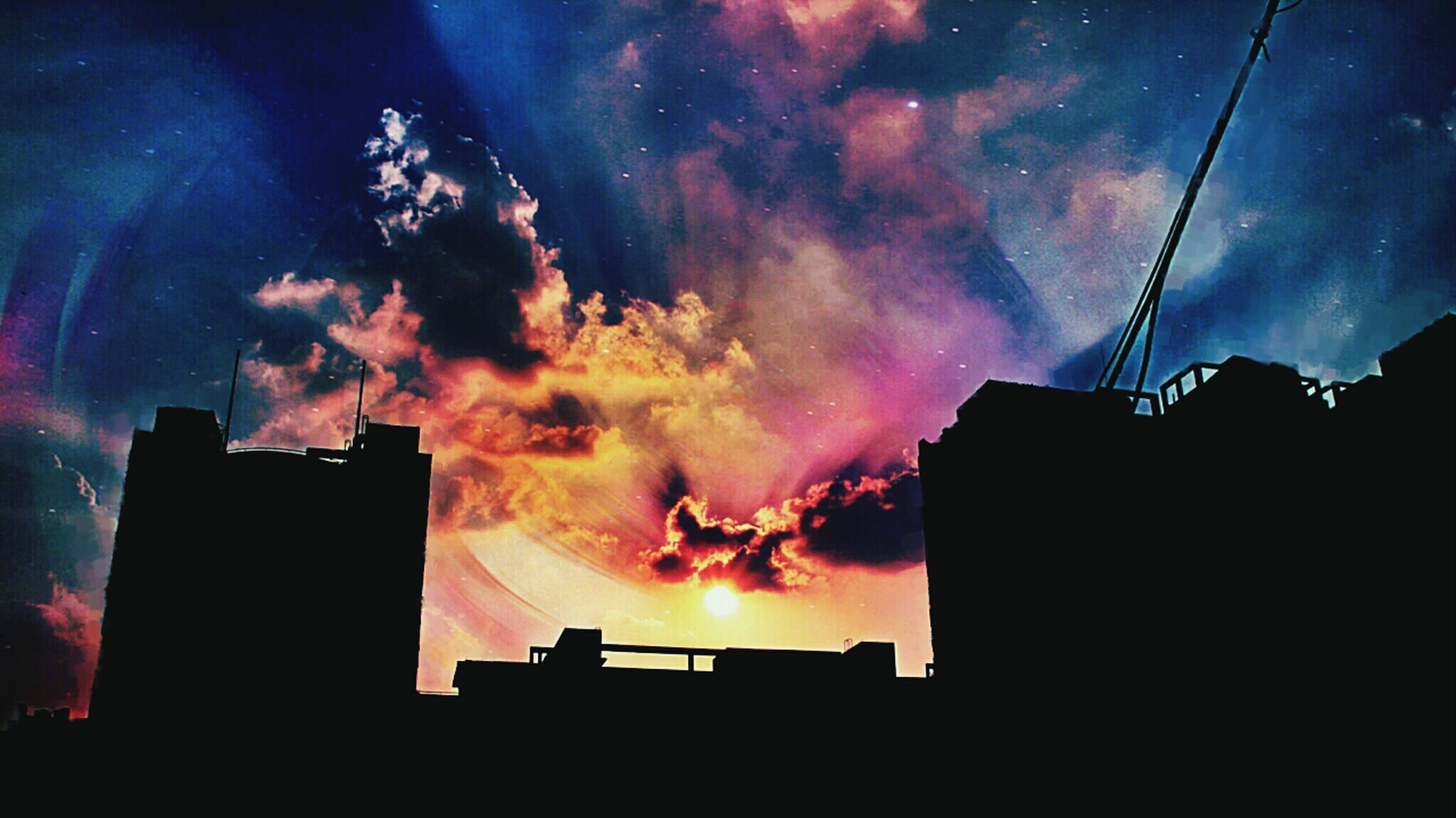 silhouette, sky, building exterior, built structure, architecture, cloud - sky, low angle view, dramatic sky, sunset, cloudy, storm cloud, weather, dusk, night, house, cloud, atmospheric mood, building, outdoors, dark