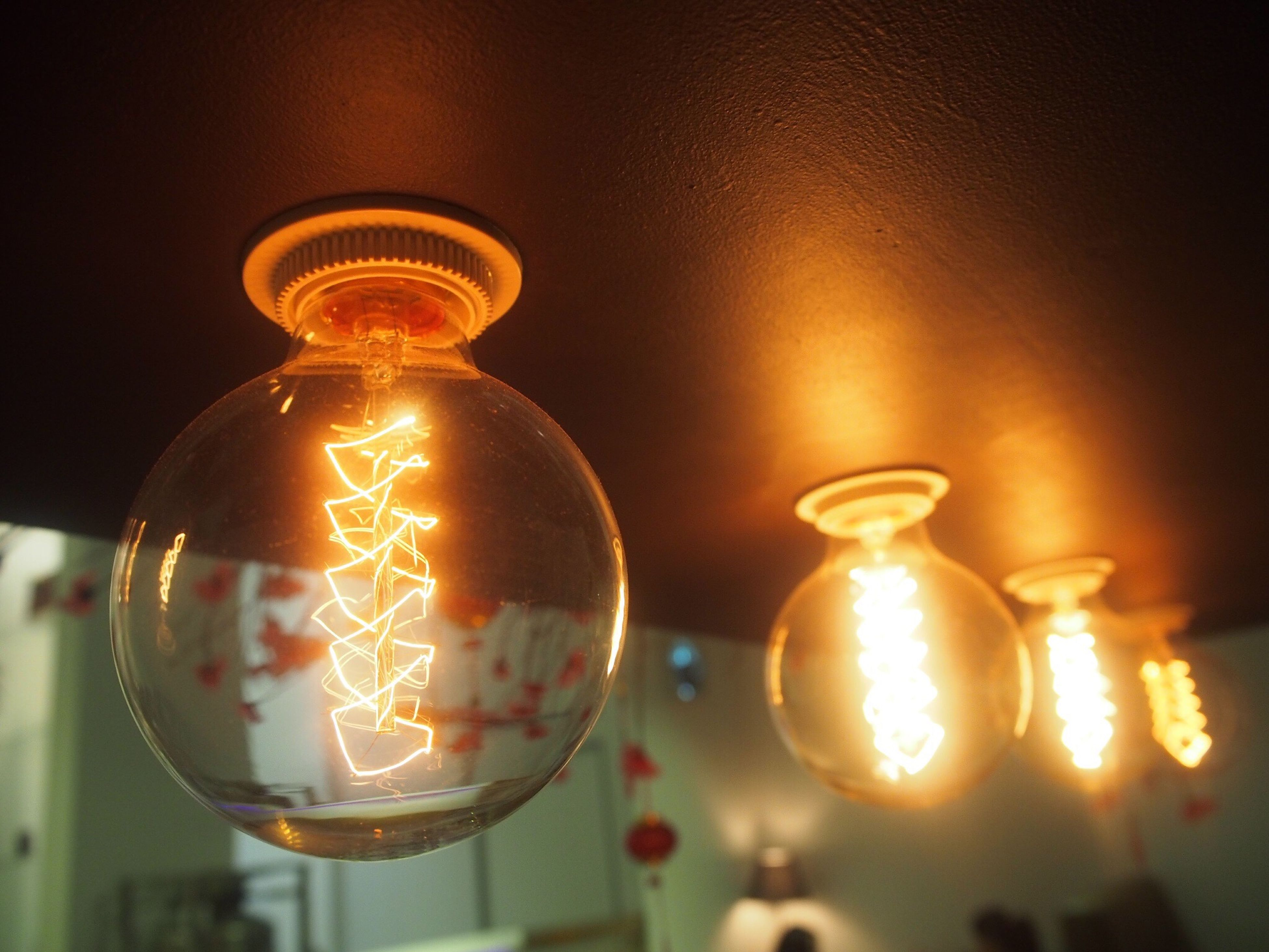 illuminated, electricity, lighting equipment, light bulb, hanging, close-up, no people, filament, indoors, low angle view