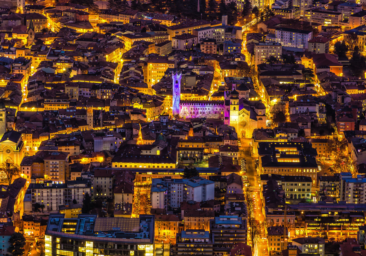 Trento in December Night Architecture Building Story Built Structure Capital Cities  City City Life Cityscape Crowded Development Financial District  Full Frame Illuminated Modern Multi Colored Night No People Office Building Outdoors Skyscraper Spire  Tall - High Tower TRENTO TONIGHT Urban Scene Yellow