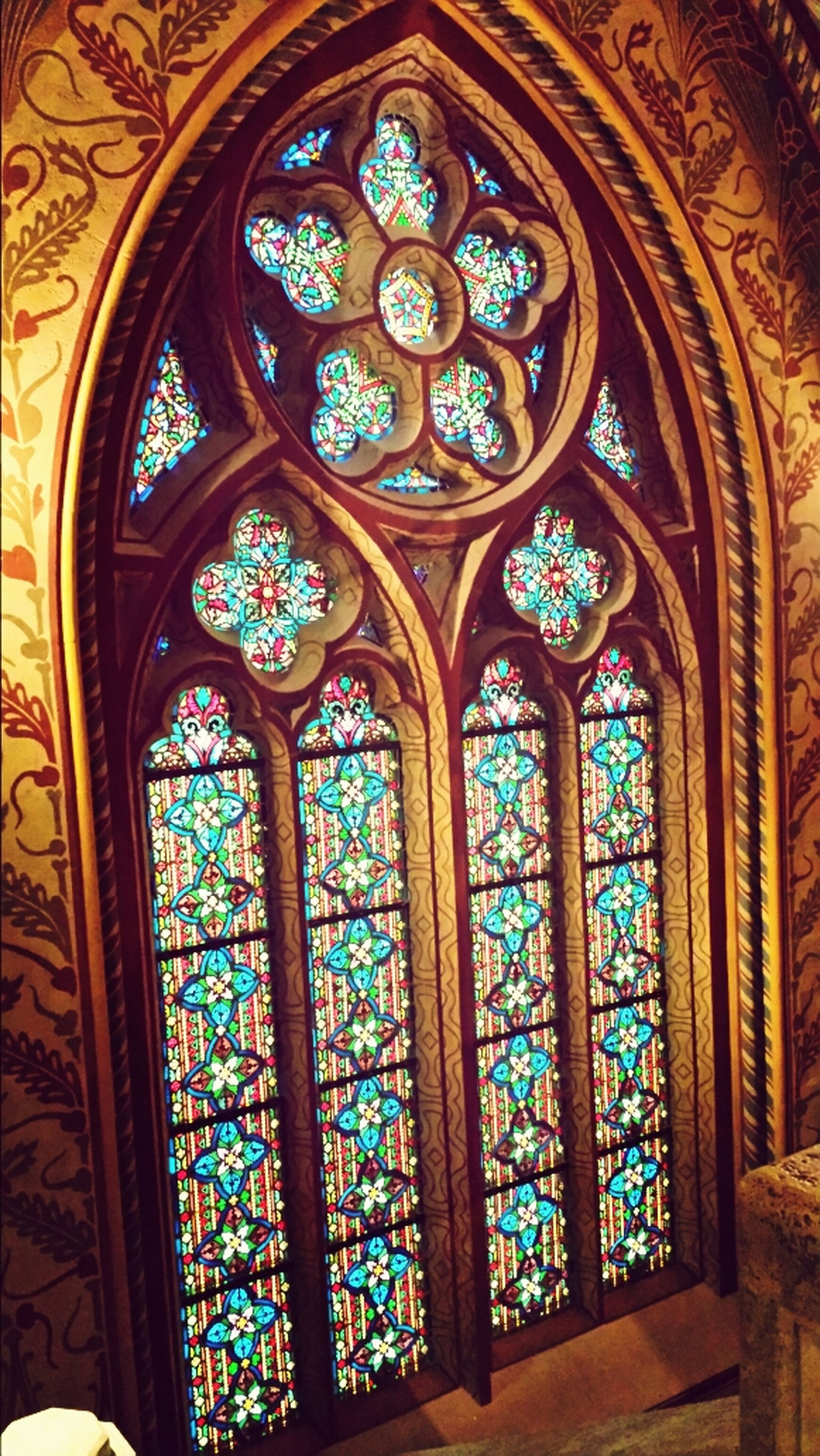 indoors, religion, place of worship, spirituality, church, stained glass, cathedral, ornate, low angle view, design, ceiling, arch, architecture, built structure, art, art and craft, pattern, window