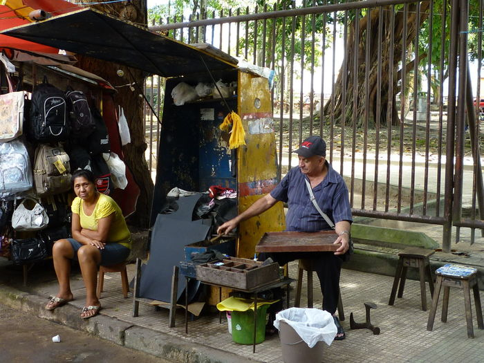 Adult Adults Only Amazonas-Brasil Day Full Length Hand Made Men Nature Only Men Outdoors People Real People Sitting Street Market Street Market Manaus Togetherness Tree Two People Working Young Adult