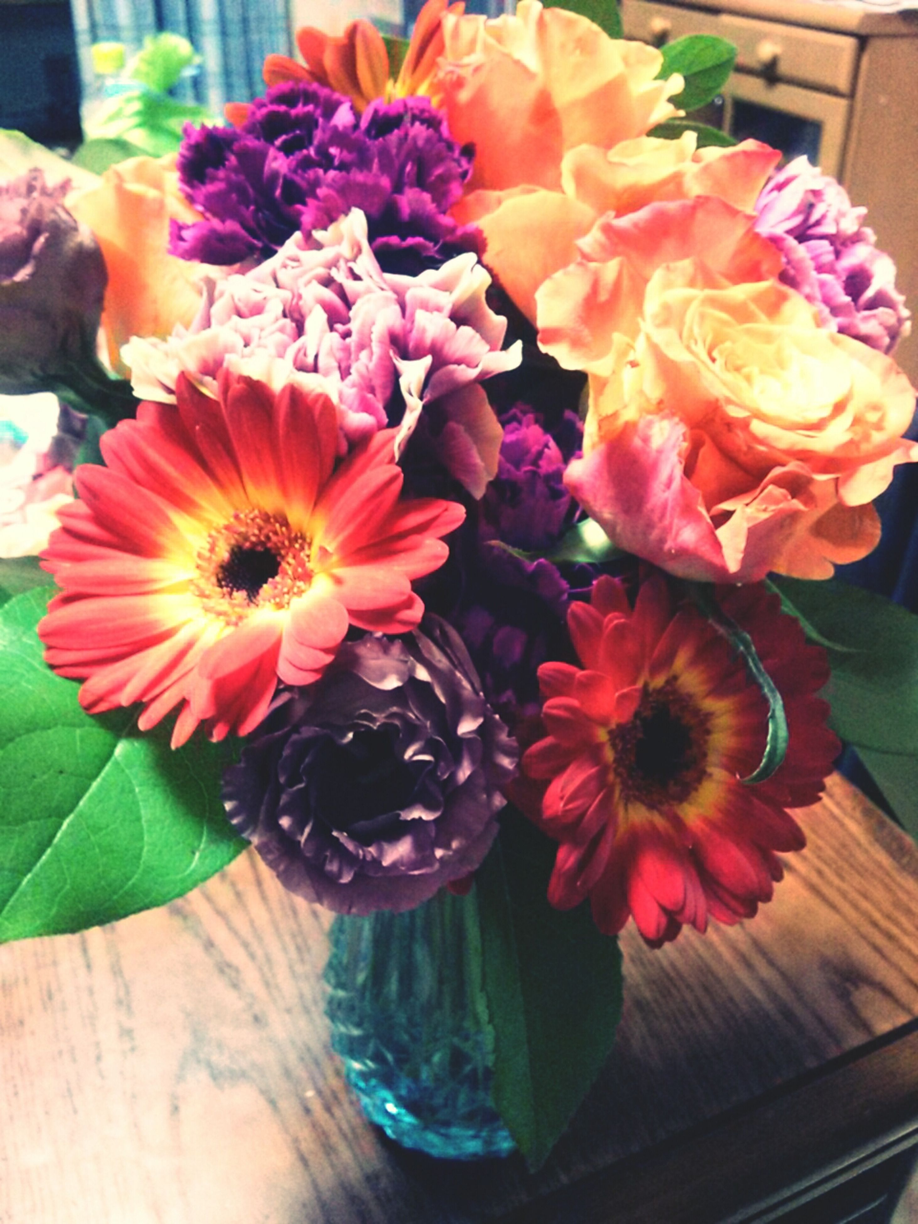 flower, freshness, petal, indoors, fragility, vase, flower head, table, bouquet, pink color, beauty in nature, flower arrangement, potted plant, high angle view, close-up, multi colored, nature, decoration, bunch of flowers, plant