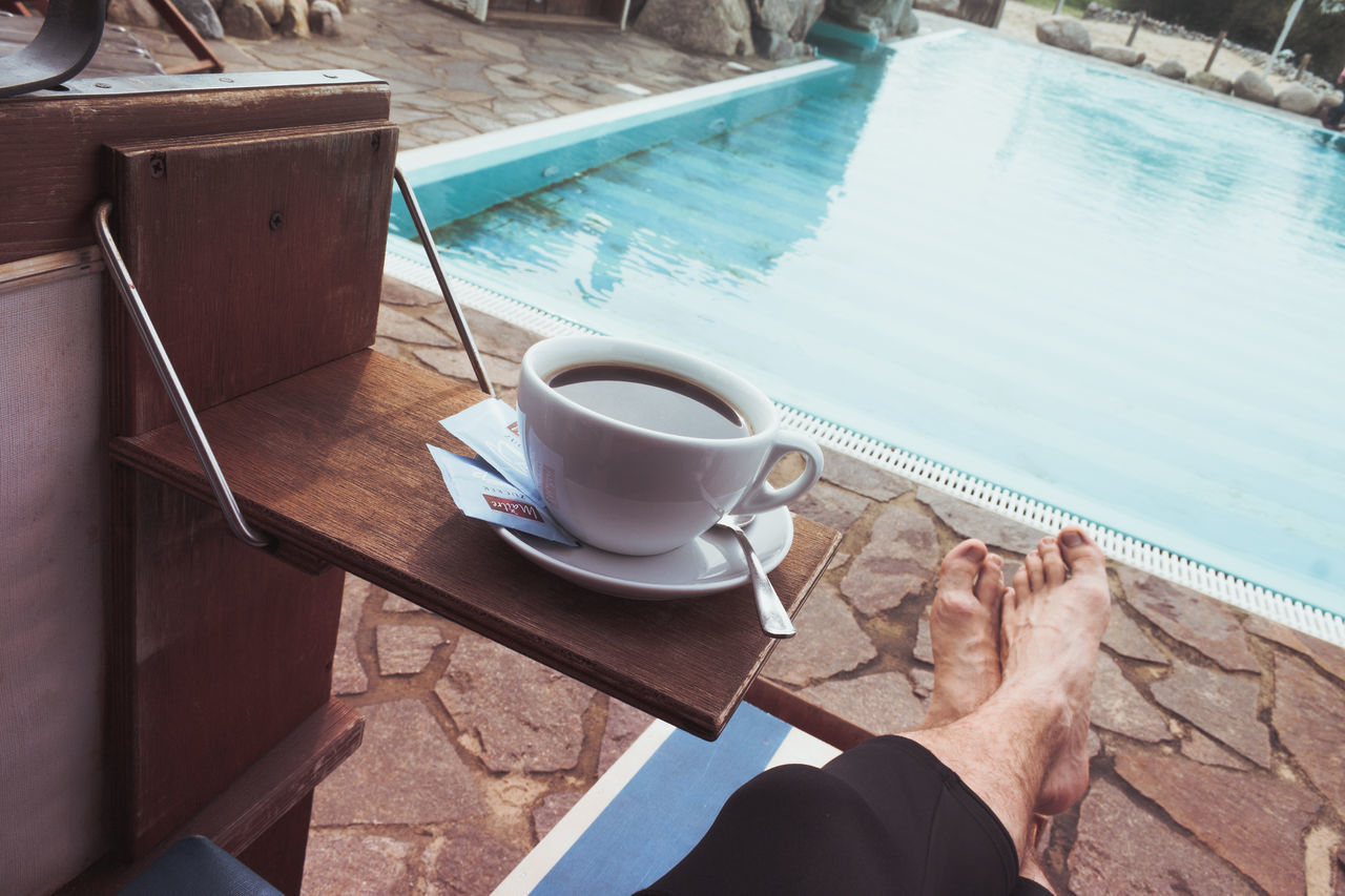 just me take a break Close-up Coffee - Drink Coffee Cup Day Drink Drinking Coffee Feet High Angle View Human Body Part Human Hand Leisure Activity Lifestyles One Person Outdoors People Real People Refreshment Relax Summer Swimming Pool Table Water Live For The Story