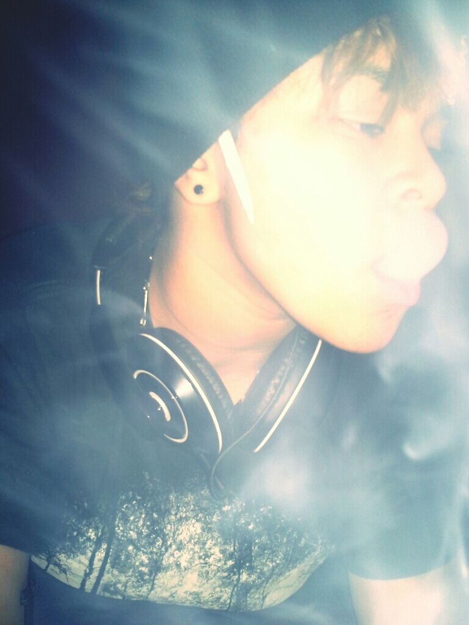 Doobie in my ear cause I keep one rolled, room always hotboxed Never smoke in the cold.